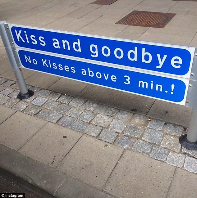 Saying goodbye: Kylie left Denmard on Saturday and came across the above sign, captioning: 'Awww, bye Aalborg! #Kisses at the airport hhahaa'