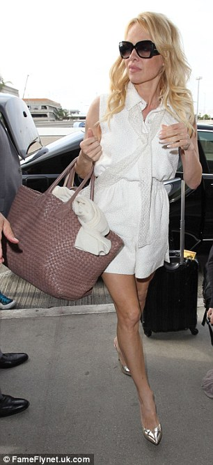 High heels: The 47-year-old actress lengthened her lean and toned legs further thanks to silvery pumps