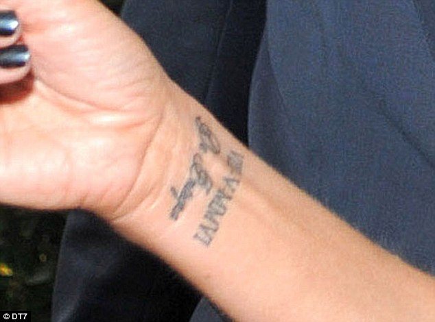 2009: The inkings, which celebrate milestones with husband David, can be seen on Victoria's right wrist