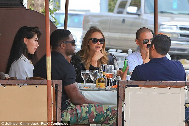 Double date: The couple were joined by NFL player Reggie Bush and his pregnant wifeLilit Avagyan