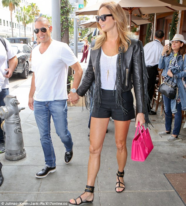 Leggy lady: The mother-of-one made sure to show off her slim pins in tiny black shorts and matching strappy sandals