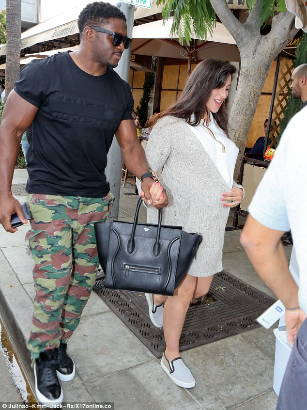 Comfortable customer: The new San Francisco 49ers running back rocked a black shirt with camouflage trousers and black leather sneakers