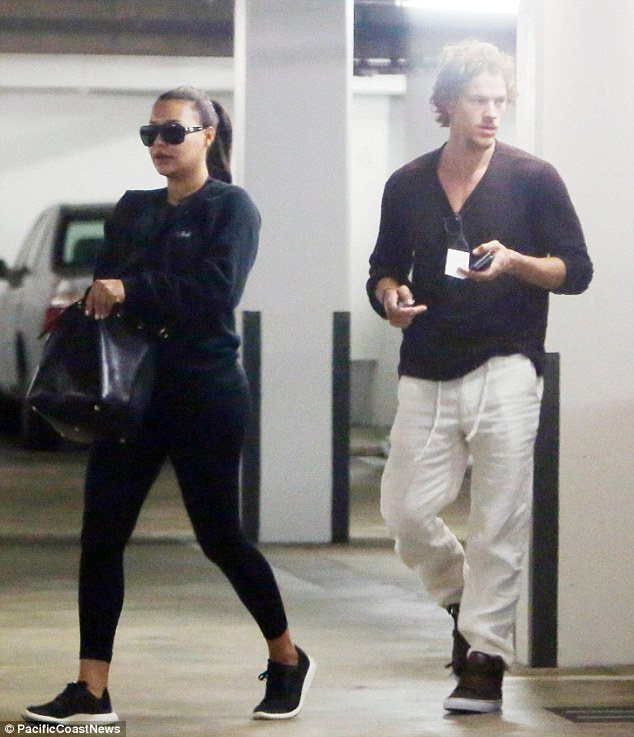 Cover up! Pregnant Naya Rivera covered up her bump behind a sleek leather tote when she stepped out in Los Angeles with her husband Ryan Dorsey on Wednesday