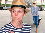 Diane Kruger loves the stripesa as she arrives from Paris at LAX  June 13. 2015 X17online.com