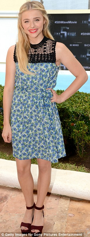 Blooming lovely: She rocked a blue, green and white floral patterned number featuring a black mesh detailing up top