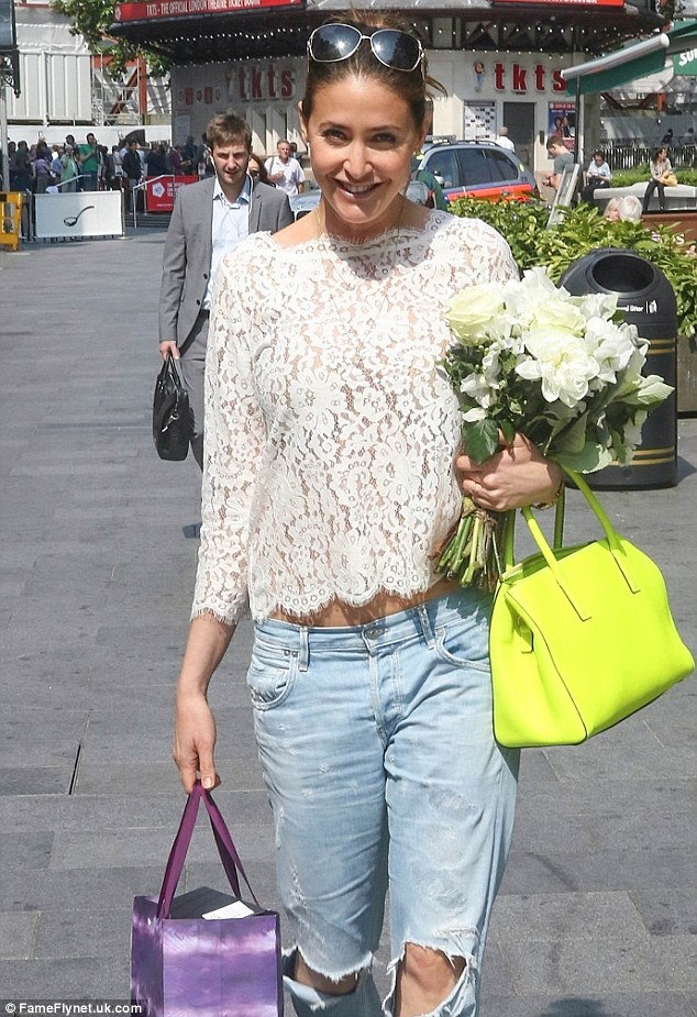 Hard to miss: The 43-year-old caught the eye in a distinctive semi-sheer top with a scalloped hemline and high crop that exposed a portion of toned torso