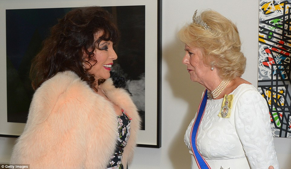 Holding her own: Indeed, she managed to hold her own when faced with Dame Joan Collins at a Royal Academy gala last week