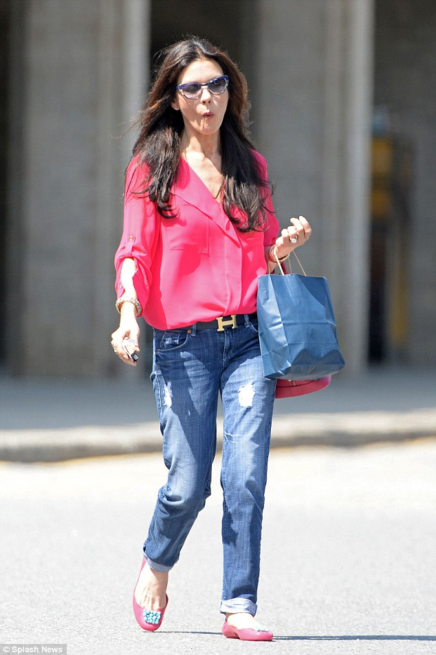 Fashion forward: Catherine Zeta-Jones stepped out wearing a low-cut hot pink shirt and ripped blue jeans
