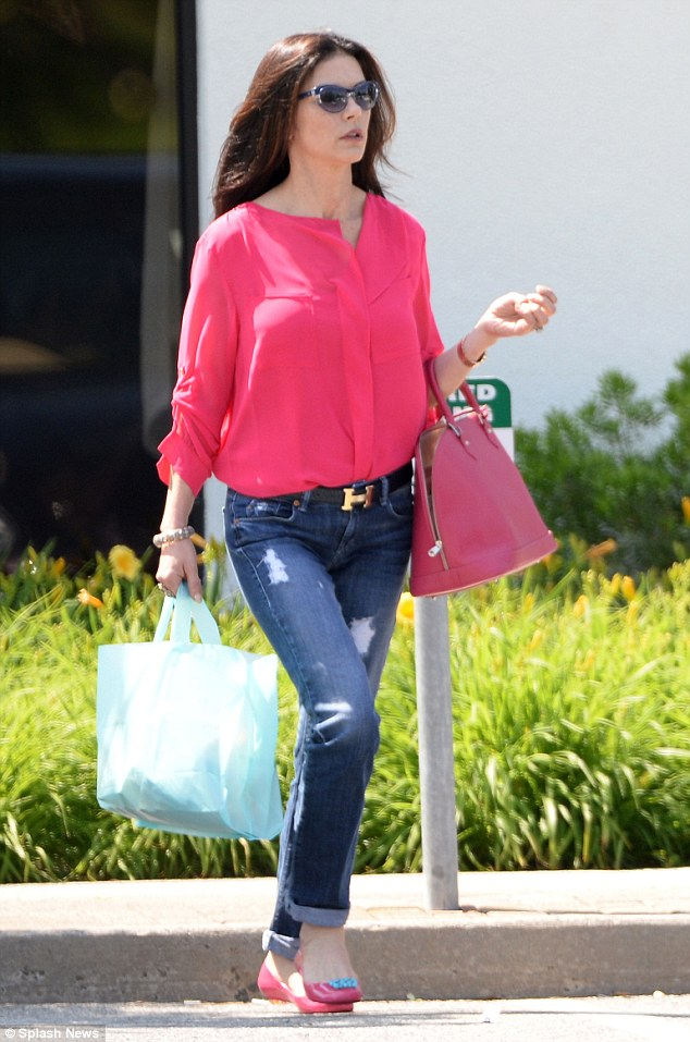 Hot pink:The star capped off her casual look with pink pumps, adorned with turquoise bows