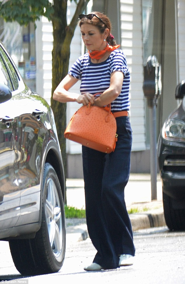 Parisian chic: The actress looked stylish in a striped navy blue and white T-shirt with an orange neck-tie