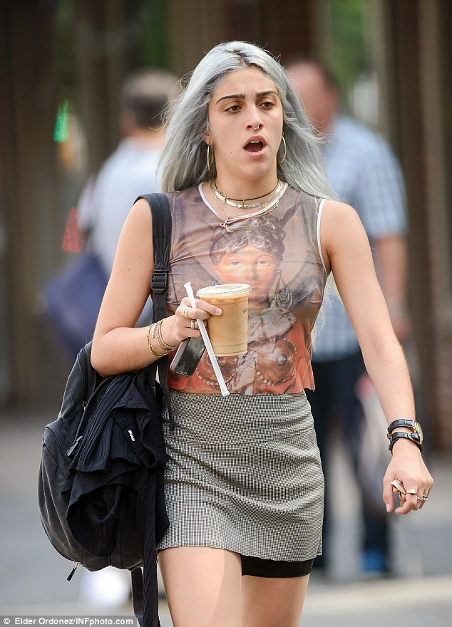 Material girl! She was seen sporting a septum piercing and large gold hoops as she walked around the city