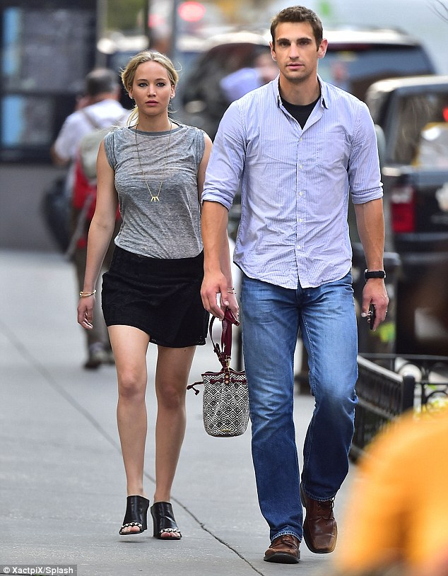 Muscle man: Jennifer Lawrence was in safe hands when she was pictured out with her hunky bodyguard Greg Lenz in New York earlier in the week