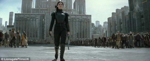 Leading the revolution: The Mockingjay is joined by the citizens of Panem for her bid to take down the government