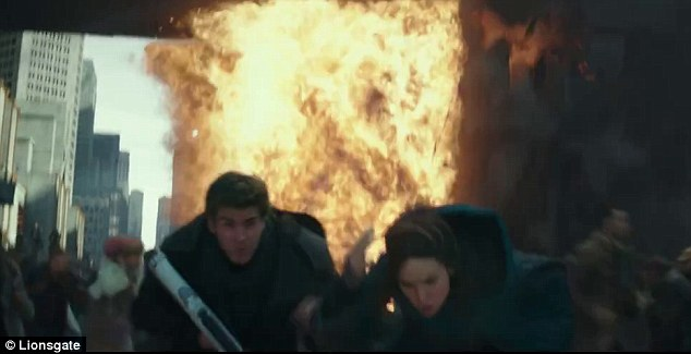 Explosive clip: Katniss and Gale run away as something blows up behind them