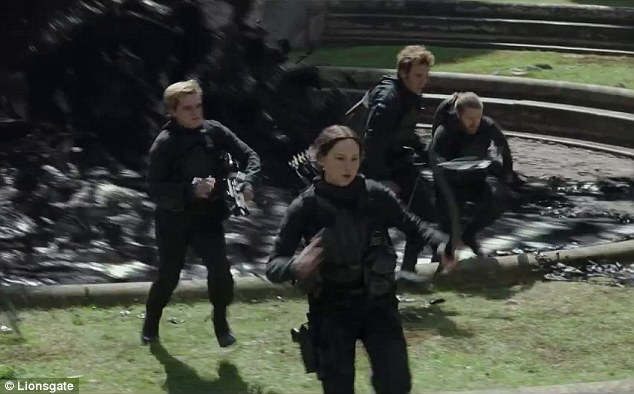 On the run: Katniss and her squad make a break for it as they are chased by a black tar-like substance