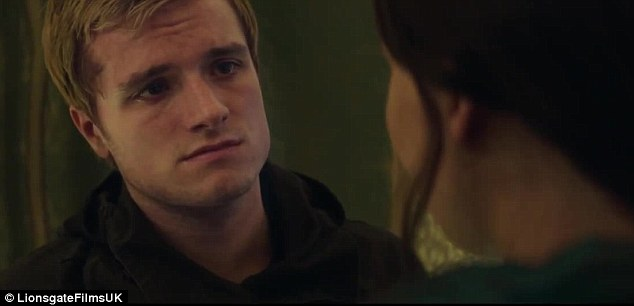 Sharing a tender moment: Peeta and Katniss exchange a worried glance
