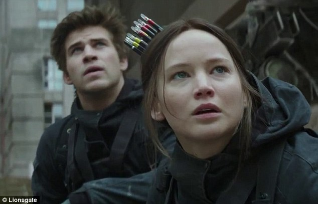 Ready to take aim: Katniss is armed with her signature bow and special arrows