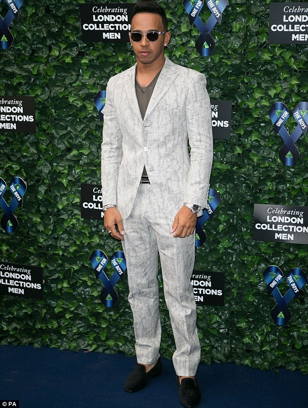 Fashion statement: Lewis Hamilton opted for an eccentric printed suit which he wore with monogrammed slippers