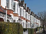 An exterior view of terraced Victorian houses with bay windows in Bedford Park, Chiswick, West London, England.  D3HTRD