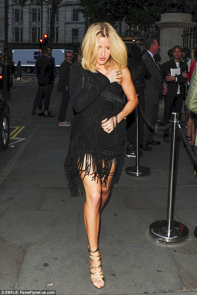 Stylish: Ellie Goulding stunned in a fringed, one-shoulder dress on Saturday which showed off her long legs
