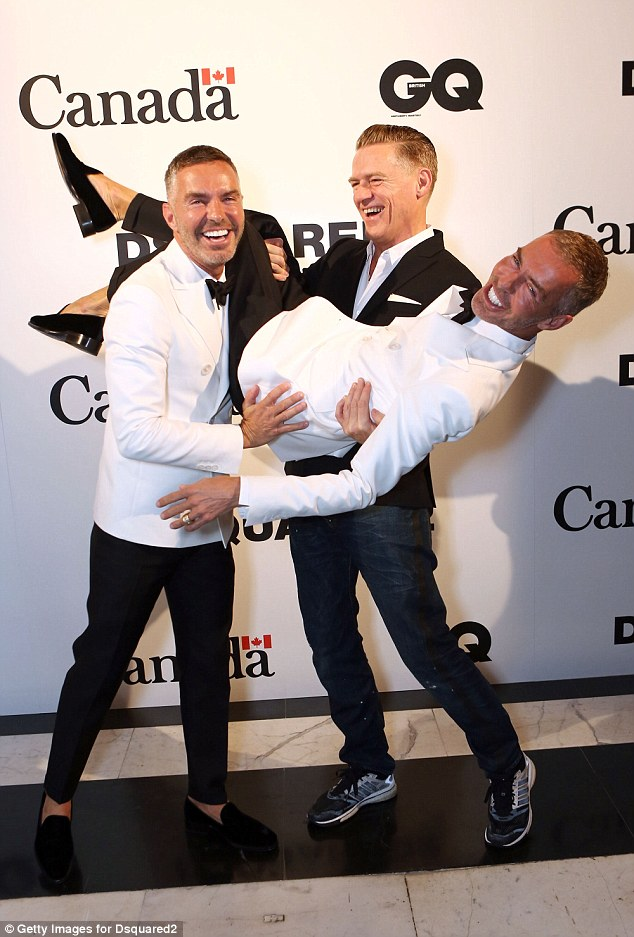 Fun on the red carpet: Bryan Adams shared a joke with the fashion designer twins