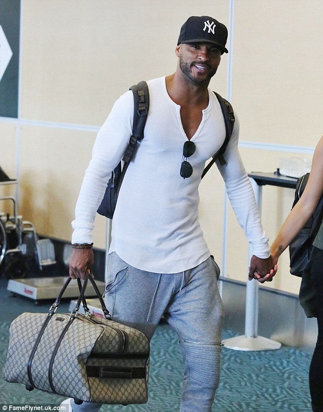 Happy: Ricky could not wipe the smile off his face as he and his new squeeze caught a flight out of Canada