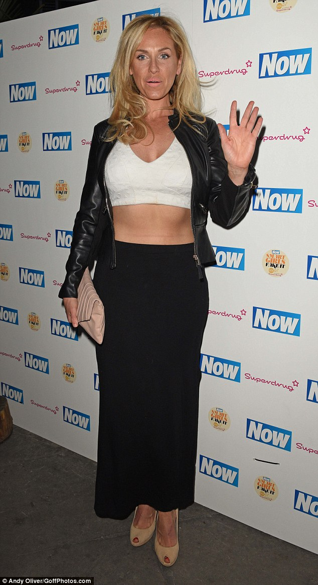 All-over tan: The Big Brother favourite didn't seem to care as she walked the red carpet at Kanaloa, showing off her overly dark skin tone