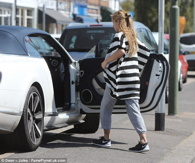 Not a good outfit: Sporting the cropped jogging bottoms with a grey pair of trainers, she added a bizarre black and white cardigan to the mix for an eclectic look
