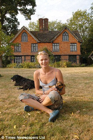 Luxury home: Jodie Kidd outside the £1.2million house in West Sussex. She is accused of refusing to pay her portion of a shared water supply bill