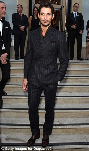 Dapper: David Gandy was smart in a black, pinstriped suit which he wore over a t-shirt and a scarf at the party