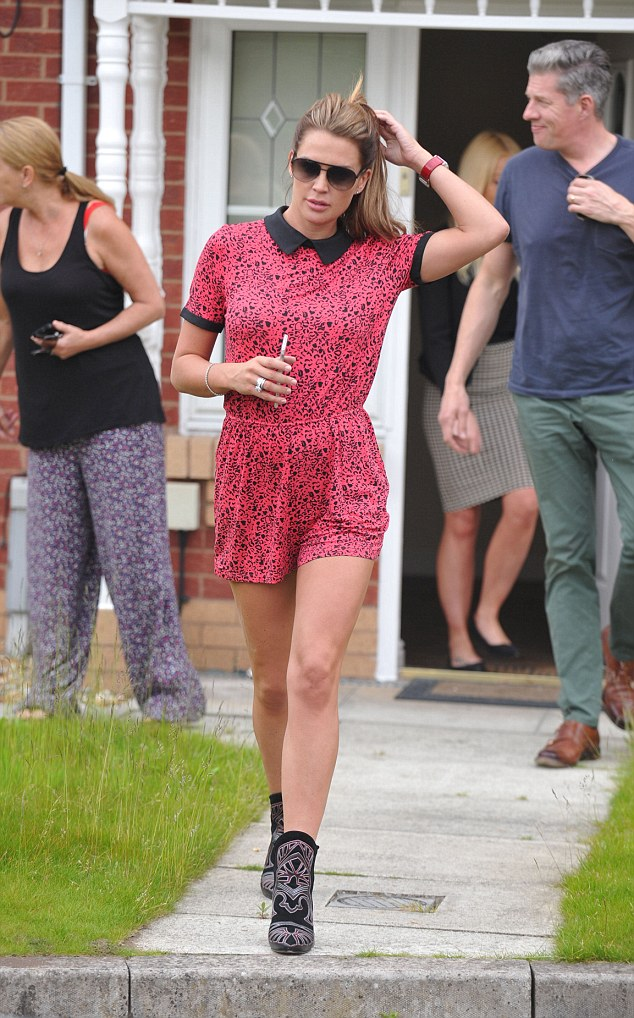 Best foot forward: Danielle elongated her legs in a pair of black cowboy boots with a silver pattern