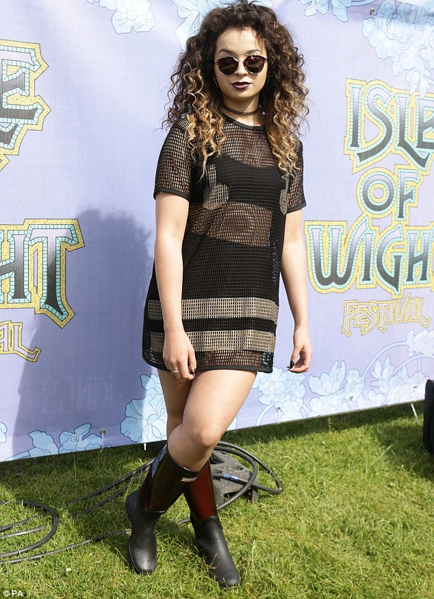 Festival style: Ella Eyre wore a sheer black dress which showed off her black underwear on the Isle of Wight