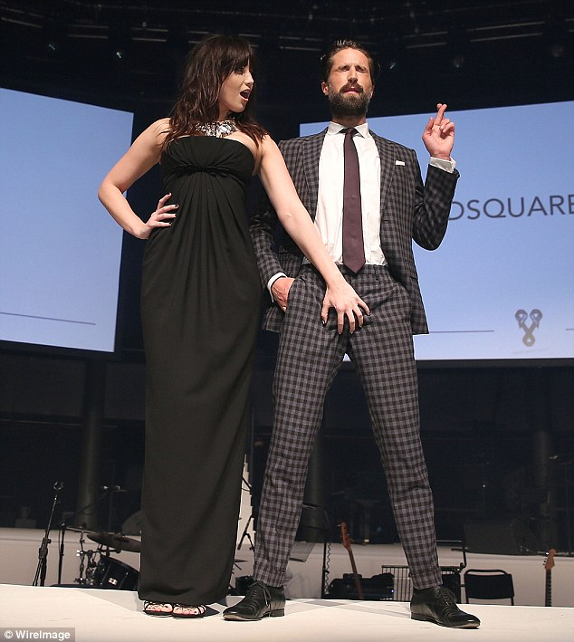 Inappropriate? Seen groping Jack while on stage, the photo op was portrayed as a joke - but was surely something that'd never happen at a women's fundraiser if the genders were reversed
