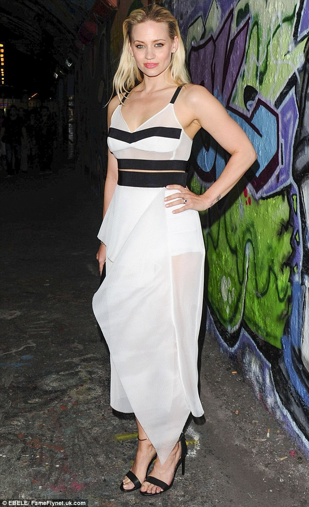 Winning style: The 33-year-old looked chic in her sophisticated dress which she teamed with black sandals