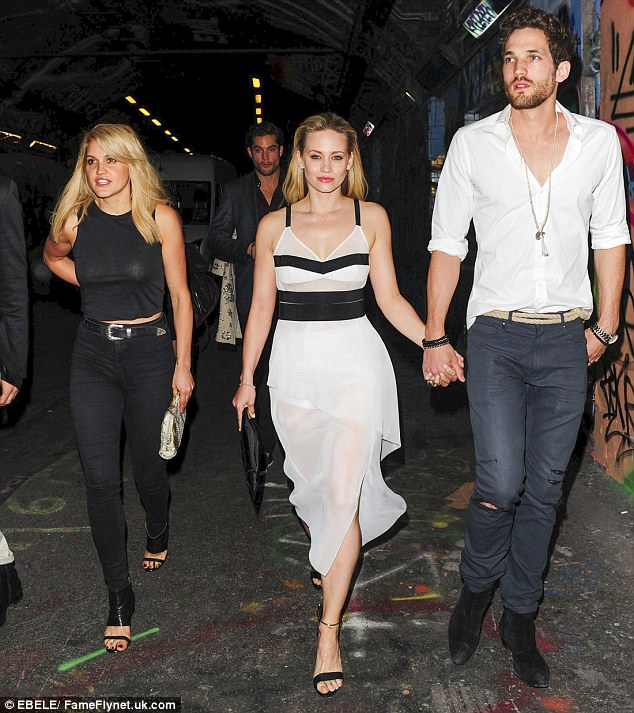 Reunion: The couple arrived at the party with Kimberly's former Pussycat Dolls bandmate Ashley Roberts
