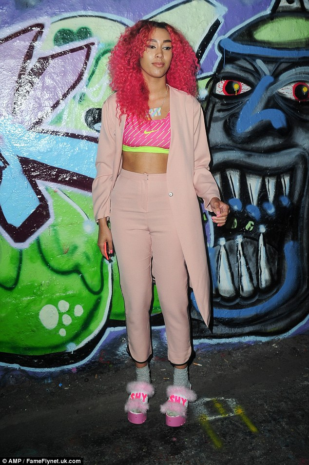 Too shy shy: Presenter Snoochie Shy matched her pink ensemble to her hair colour - and ensured people remembered her name with her custom-made shoes