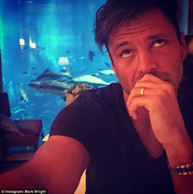 Loving life: Mark wasn't shy about sharing selfies on his honeymoon. He displayed his wedding ring as he posted  pictures from his suite at the Atlantis Palm resort in Dubai, saying he couldn't decide whether to go out or stay in