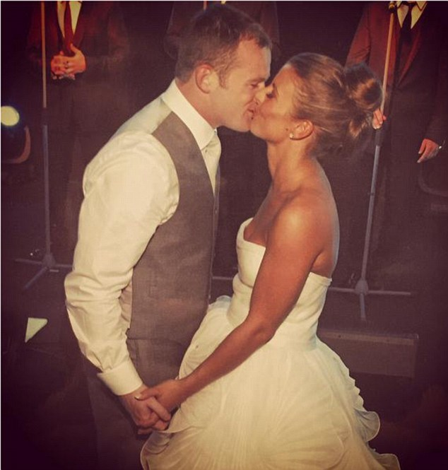 Happy day: Coleen Rooney shared a flashback snap of her and husband Wayne on their wedding day, seven years after they tied the knot