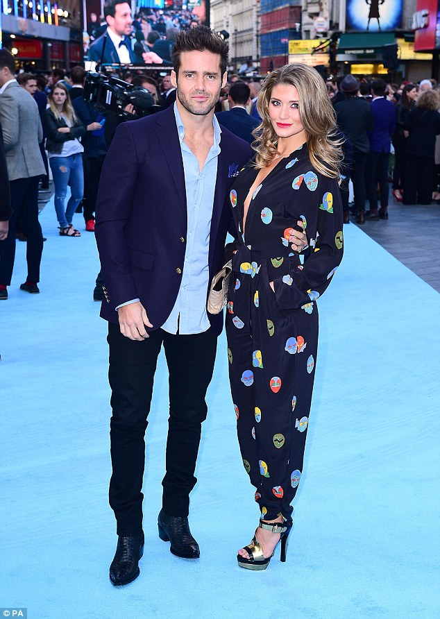 Chic: Lauren looked gorgeous in a print jumpsuit which featured a daring neckline as she posed with Spencer