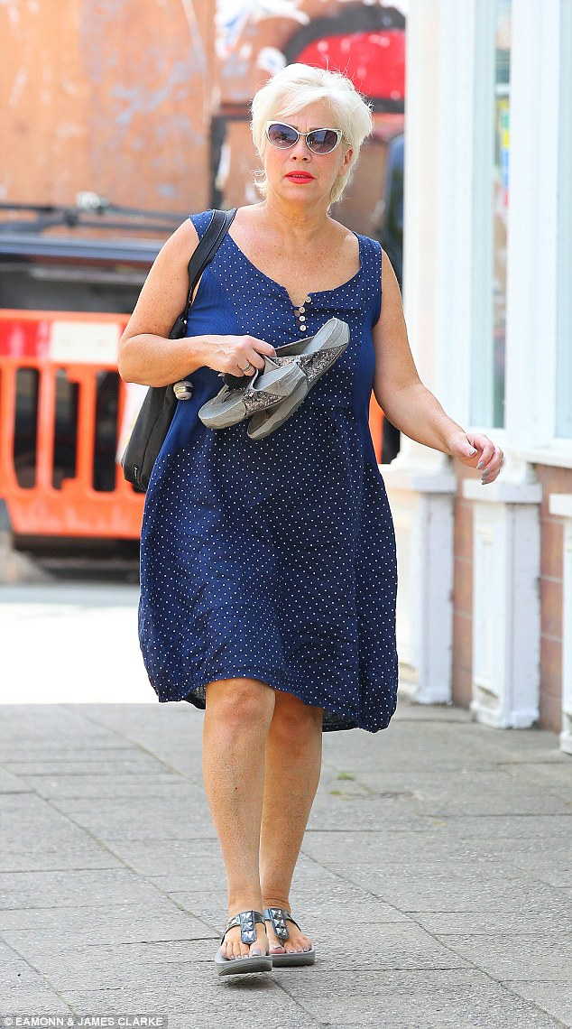Covering up: Denise Welch opted for comfort over style as she donned a flowing navy dress as she stepped out in Cheshire on Friday