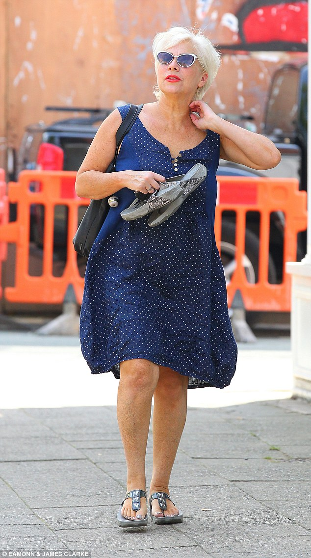 Tanned: The star sported a sunkissed look - and appeared blonder than ever as she headed out for lunch