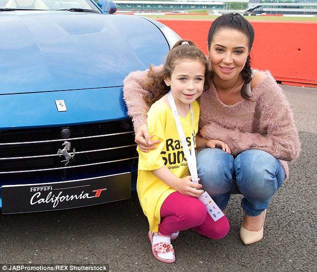 Happy day out: Tulisa spent Friday morning with some 50 seriously ill children, who were over the moon to meet their X Factor judge idol
