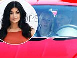 Tyga test takes a test drive in a red Bugatti with a hot blonde riding shotgun. June 12, 2015 X17online.com