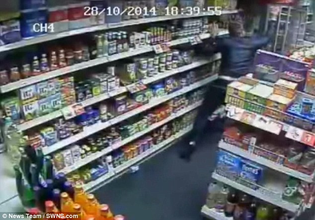 A thug is seen kicking and throwing heavy glass jars and tins at the victim who was left with a fracture to his back, permanent scaring to his forehead and a fracture to his thumb