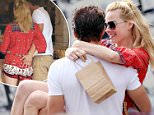 138564, EXCLUSIVE: Margot Robbie gets a visit from boyfriend Tom Ackerley, packing on the PDA in Toronto while she's in town shooting Suicide Squad. The pair obviously missed each other as were seen after lunch kissing and dancing inside the ice-cream shop, even sharing their desserts. As they were leaving for their car Tom scooped Margot up and the two started making out. Toronto, Canada - Thursday June 11, 2015. CANADA OUT Photograph: © PacificCoastNews. Los Angeles Office: +1 310.822.0419 sales@pacificcoastnews.com FEE MUST BE AGREED PRIOR TO USAGE