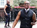 10 JUNE 2015  - LONDON  - UK\n*** EXCLUSIVE ALL ROUND PICTURES ***\nFORMER BOXING CHAMPION CHRIS EUBANK IS SPOTTED LOOKING HIS ECCENTRIC SELF AS HE IS PICTURED GOING FOR LUNCH WITH FRIENDS, CHRIS STOOD OUT IN HIS SLEEVELESS SUIT AND STOPPED TO POSE FOR SELFIES WITH SOME BUILDER FANS .\nBYLINE MUST READ : XPOSUREPHOTOS.COM\n***UK CLIENTS - PICTURES CONTAINING CHILDREN PLEASE PIXELATE FACE PRIOR TO PUBLICATION ***\n**UK CLIENTS MUST CALL PRIOR TO TV OR ONLINE USAGE PLEASE TELEPHONE  442083442007