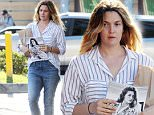 Drew Barrymore stopped at the Hollywood market to buy alcohol and a magazine.\n\nPictured: Drew Barrymore.\nRef: SPL1053526  140615  \nPicture by: JLM / Splash News\n\nSplash News and Pictures\nLos Angeles: 310-821-2666\nNew York: 212-619-2666\nLondon: 870-934-2666\nphotodesk@splashnews.com\n