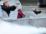 James Bond continued filming the movie 'Spectre' with an exciting scene involving a speedboat, a gun, helicopters and the Houses of Parliament in London, England. A stuntman, who looked to be the double of Daniel Craig and a stuntwoman, reported to be Lea Seydoux's character, chased after a helicopter in a speedboat and started shooting his Walther PPK at it! They continued down the Thames for a daring finale outside the iconic House of Parliament where one helicopter swooped down while being filmed by the other helicopter. Residents were wowed by the dangerous manoeuvres for the eagerly anticipated 24th Bond film.\n\nPictured: James Bond, Spectre, London, England\nRef: SPL1054042  140615  \nPicture by: CW/Splash News\n\nSplash News and Pictures\nLos Angeles: 310-821-2666\nNew York: 212-619-2666\nLondon: 870-934-2666\nphotodesk@splashnews.com\n