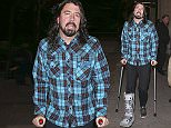 Picture Shows: Dave Grohl  June 14, 2015\n \n Foo Fighters singer Dave Grohl seen out and about on crutches in London, UK. The American rock musician sustained a fracture in his leg as he fell from a stage during a concert in Sweden. \n \n Non Exclusive\n WORLDWIDE RIGHTS\n \n Pictures by : FameFlynet UK © 2015\n Tel : +44 (0)20 3551 5049\n Email : info@fameflynet.uk.com