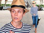 Diane Kruger loves the stripesa as she arrives from Paris at LAX  June 13. 2015 X17online.com